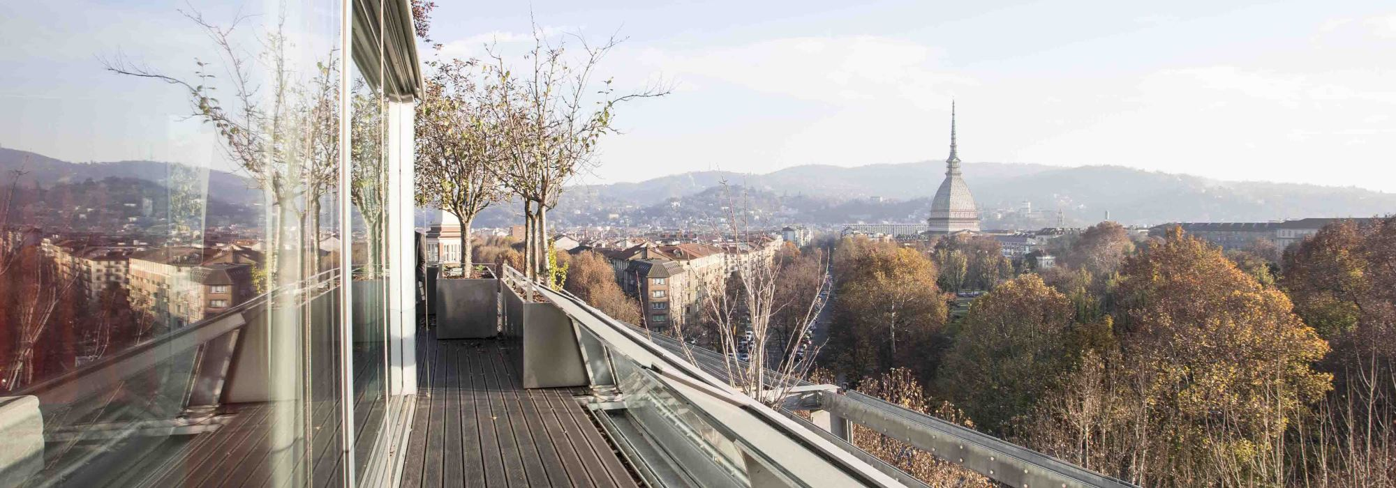 Penthouse of 320 mqs with terraces in Hollywood House, in front of the Royal Gardens (Giardini Reali)